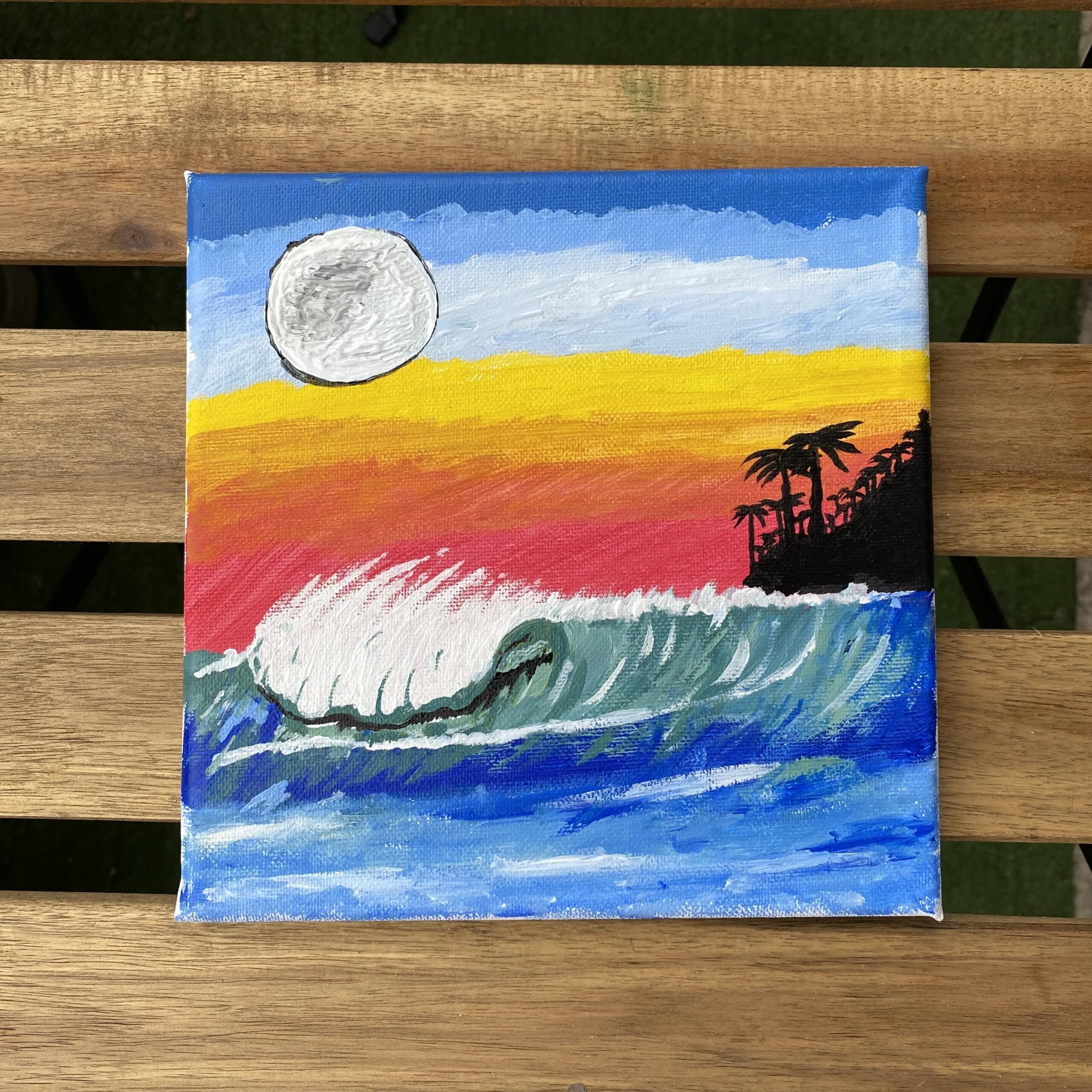 Painting of the ocean, moon and sunset